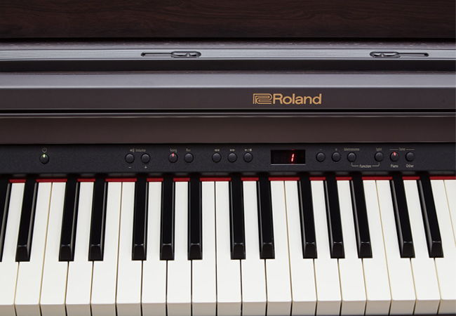 piano điện roland 302 .